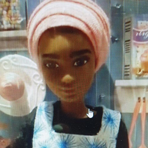 The Nadiya doll was wearing her own version of Blisshome's Make Life Colourful aprons.
