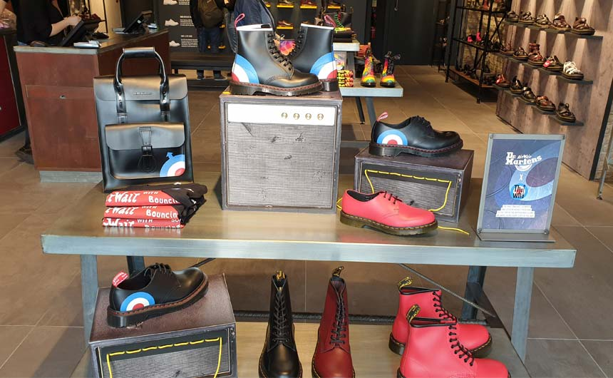 Dr Martens highlights its licensed collaborations well with in-store theatre and window displays.