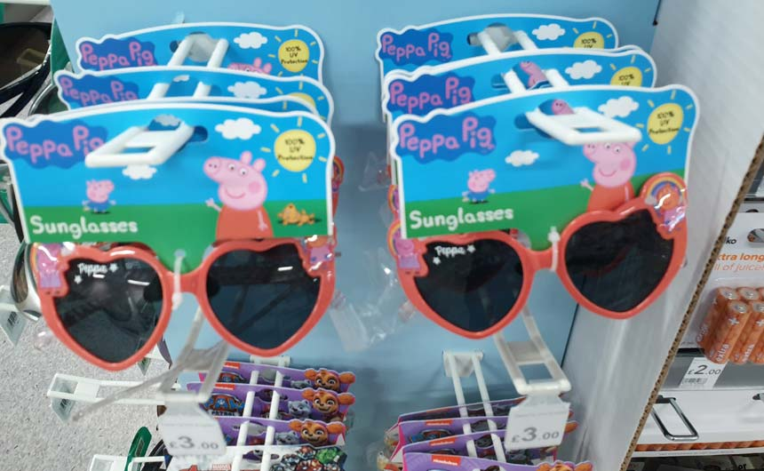 Peppa Pig sunglasses were on clip strips near Wilko's suncare products.
