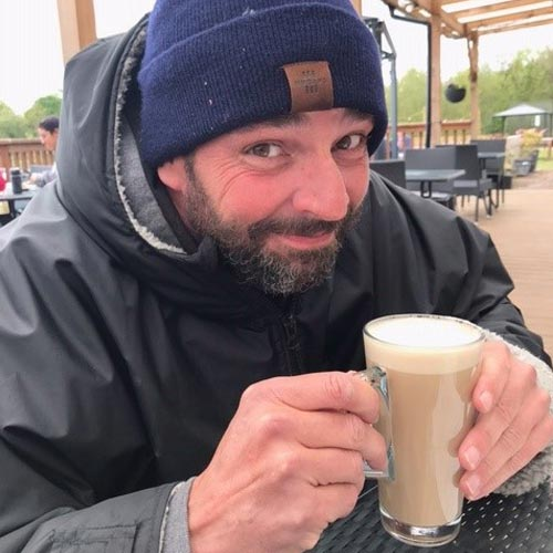 Mark Bezodis from Perry Ellis International warms up with a coffee.